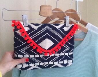 Pom Pom Clutch Bag