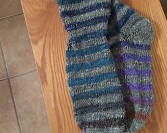 Hand-knitted gray and teal striped socks