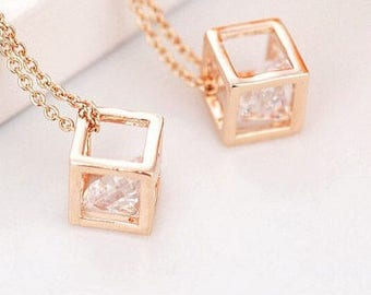 Crystal in hollow cube pendant