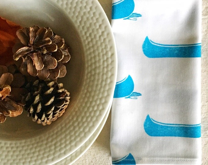 Set of four organic cotton dinner napkins, turquoise canoes