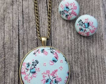 Pale blue floral fabric button jewelry