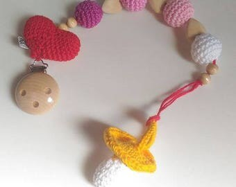 Dummy holder with heart amigurumi and untreated beech wood in shades of pink
