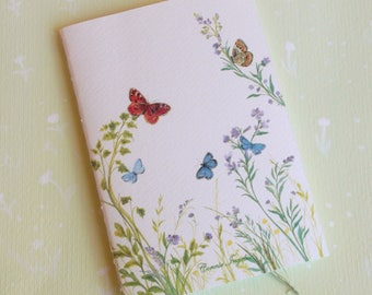 Small Notebook with image of flowers and butterflies on the cover