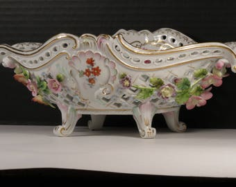Vintage Voigt Brothers Sitzendorf Reticulated Oval Porcelain Centerpiece Bowl with Applied Flowers and Rosettes, ca. 1900-1902.