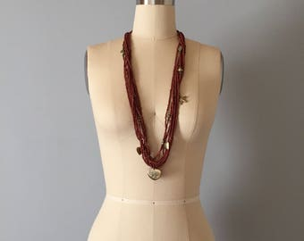 auburn red micro seadbeaded layering necklace | brass star and heart charm necklace