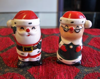 "Mrs. and Mr. Santa Claus Salt and Pepper Shakers - 3.5"" tall"