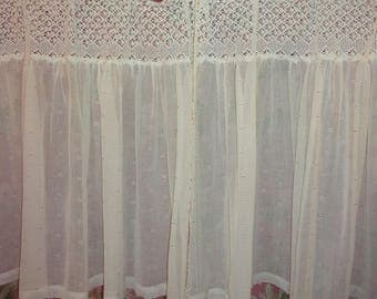 A pair of curtains made of old fabric and antique lace