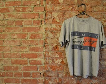 RARE!! Vintage 90s Bootleg Tommy Hilfiger Flag Spell-Out Unisex T-Shirt
