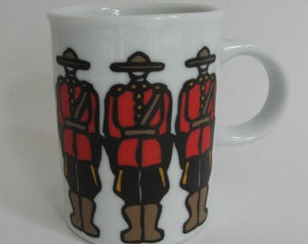 Mug from Canada by Marc Tetro with image of Mounties