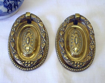 Pair antique brass drawer pulls, late Georgian / Regency. Salvaged drawer handles. Embossed sunflowers and wreaths with berries.