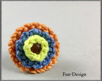 Ring with crochet flower