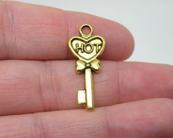 "12 Gold Tone ""Hot"" Skeleton Key Charms or Pendants. B-018"