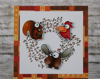 Card with brown wreath and funny animals
