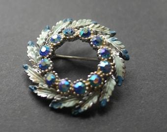 Painted blue enamel circular leaf brooch with aurora borealis rhinestones
