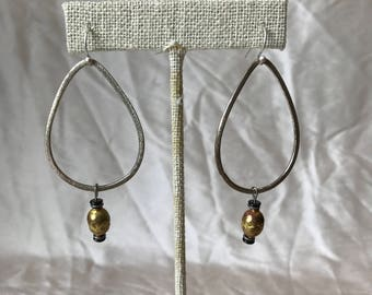 Silver raindrop earrings with rustic brass prayer bead