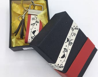 Keychain/bag charm with its box with