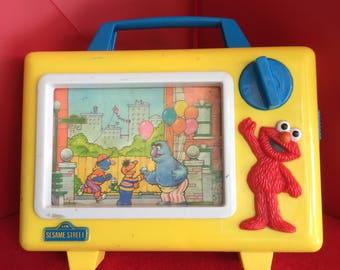 Vintage Tyco Preschool ELMO Musical Windup TV Toy Sesame Street Jim Henson Productions