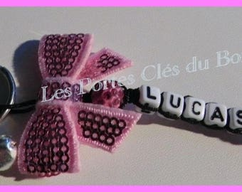 key 1 black and pink name with bow