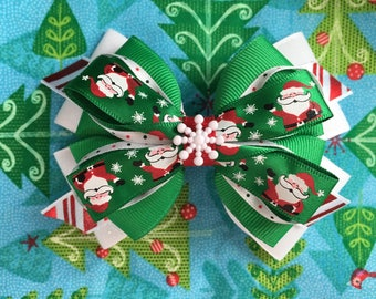 Christmas Santa hair bow. Handmade hair bow. Red green and white hairbow.