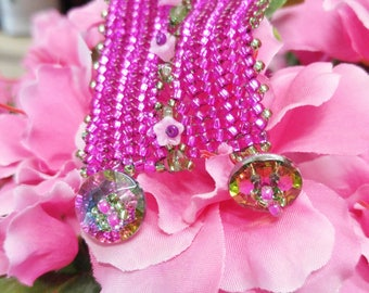 Powerful eye-popping hot pink bracelet with bedazzling button clasps