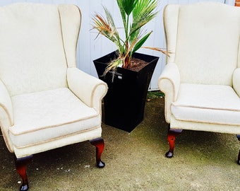 vintage wing back arm chairs, cream, upholstered, lovely condition, seeing as a pair of 2 , very comfortable chairs