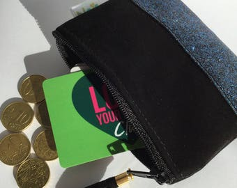 Black leather wallet, and blue glitter fabric