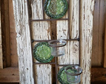 Green Glass Candle Holder on Distressed Wood