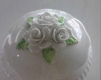 Small, delicate porcelain lidded dish, with white rose embellishment on lid