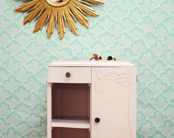 Gold and pale pink bedside table