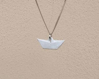 Handmade necklace origami boat