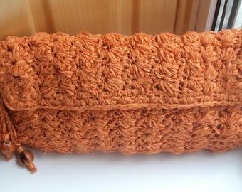 Crocheted orange clutch