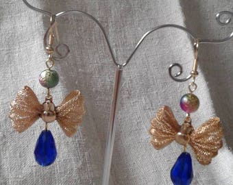 """gold tone knot"" earrings"