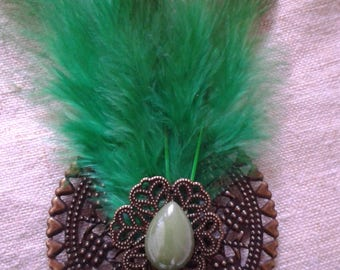 "brooch ""Feather and green cabochons"""
