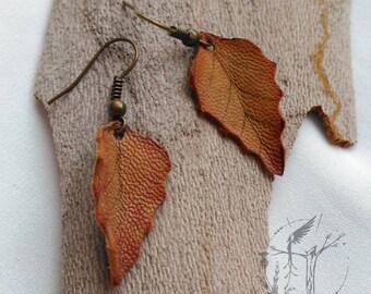 Slope of dry leaf. Handmade Leather pendant