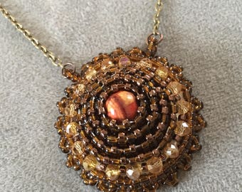 "Bead embroidery.  Brown beaded embroidery necklace with 21"" copper chain.  Pendant."