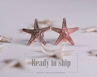 Small rose gold starfish stud earrings
