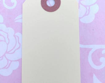 Medium and Small size Manila Shipping Tags. Price Tags. Hang Tags and Traveling Tags.