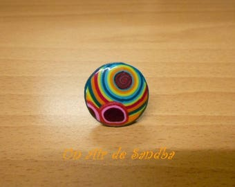 "Adjustable ""Pop"", polymer clay and metal ring."