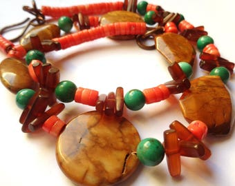 Necklace in African jade, natural turquoise, horn and natural coral with copper finish