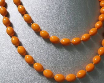 Vintage orange oval beaded single strand necklace