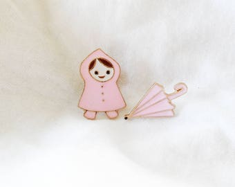 Little girl with umbrella pin