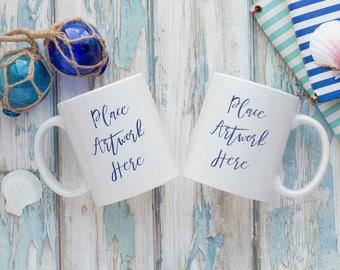 White Double Mug Mockup - blue weathered wood background