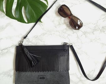 Suede leather crossbody bag with tassel and black moustache