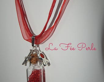 Topped with mini glass bottle pendant red beads
