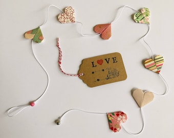 Garland with 7 pink and green origami paper hearts Bell