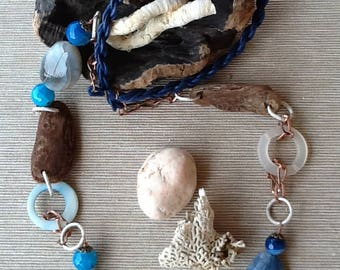 Turquoise and blue necklace with semiprecious stones and small beached Woods.