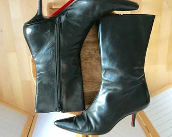 Louboutin (size 36) black leather boots. Stiletto kitten heels. Beautiful red sole shoe for a tiny footed lass.