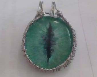 Wire wrapped green dragons eye pendant