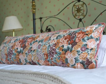 double bed sized giant bolster cushion in rose print with pink velvet piping measures 45cm