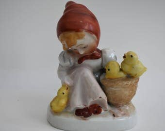 Geramic Girl Figurine Looking Down at a Yellow Chick and Holding a Basket with Two Yellow Chicks Vintage